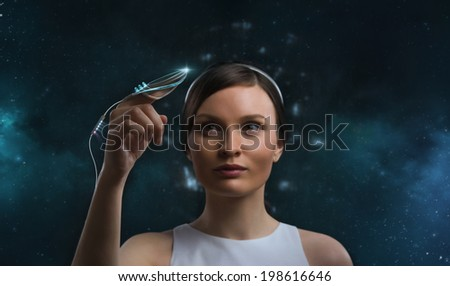 People of the future. Pretty woman against cosmic background