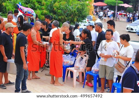 People offer food to monk when Buddhist Sabbath at Tha-pha temple Ratchaburi  Thailand (17-10-2016)