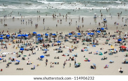 People on crowded beach - stock photo