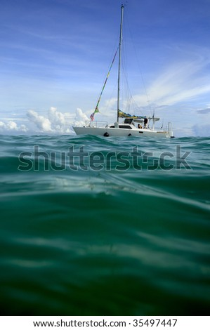 people on sailing boat in the pacific ocean, taken in Samoa