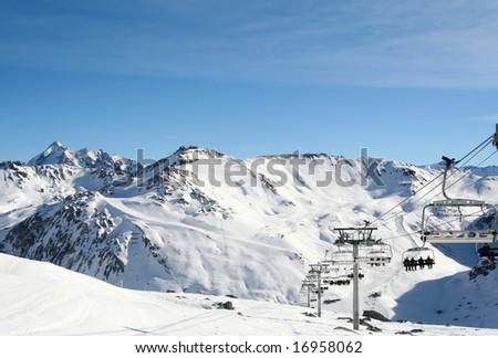 People on ski lift at ski resort Tinge France - stock photo