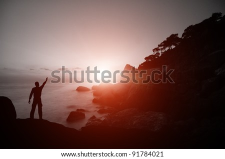people on the beach at sunset. marine composition. dramatic scene
