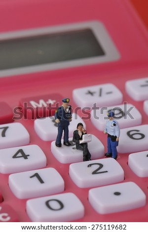 People on the calculator - stock photo