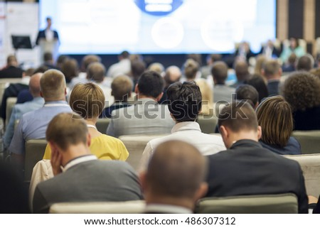 People on the Conference Listening to the Lecturer. Back View. Horizontal Image Composition