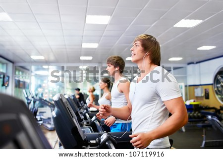 People on treadmills at fitness club