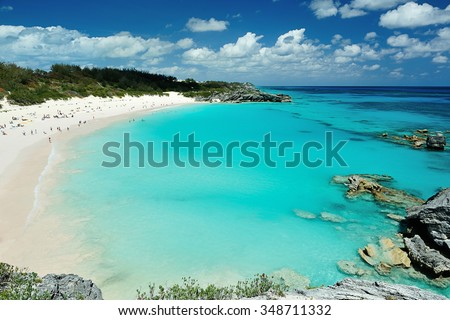 People on vacation in Pink Sand beach Bermuda - stock photo