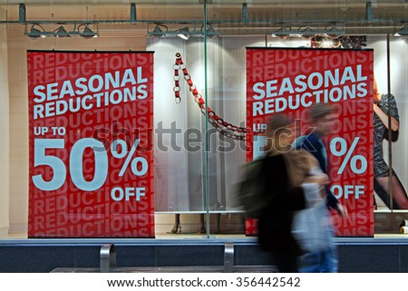 People out shopping in the post christmas sales - stock photo