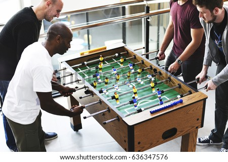 High Quality People Playing Enjoying Foosball Table Soccer Game Recreation Leisure