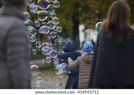 people playing with soap bubbles