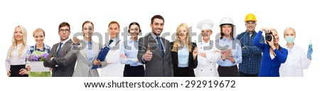 people, profession, qualification, employment and success concept - happy businessman over professional workers showing thumbs up - stock photo