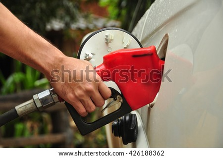 people pumping gasoline fuel in car - stock photo