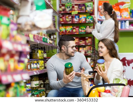 People purchasing the food for week at supermarket  - stock photo