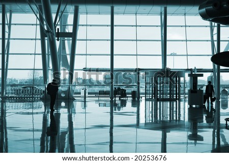 people reflections in the airport - stock photo