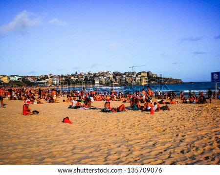 people relaxing at bondi beach on a sunny day - stock photo