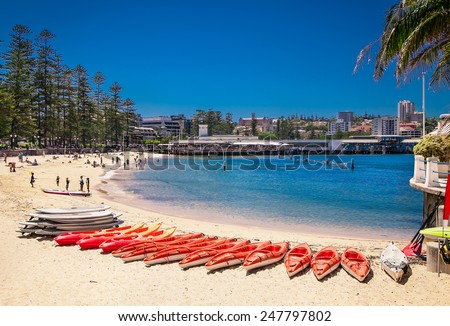 People relaxing at one of Manly beaches in Sydney, Australia. - stock photo
