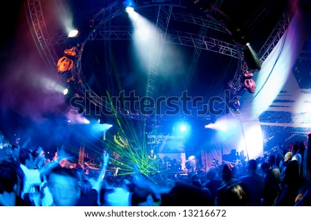 People relaxing at the concert, laser show and music - stock photo