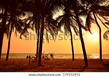 People Relaxing on Sunset Beach  - stock photo