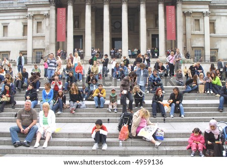 People relaxing outside the national gallery. Trafalgar square, london. - stock photo