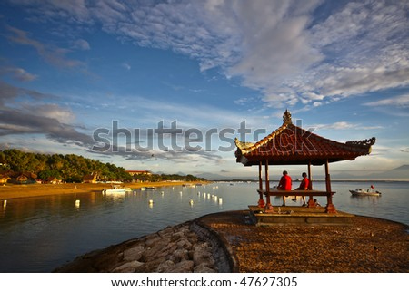people resting near by the calm sea - stock photo