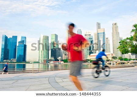 People runing and cycling in the morning in Singapore