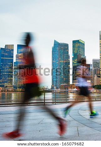 People runing in the evening at a quaysibe of Singapore - stock photo