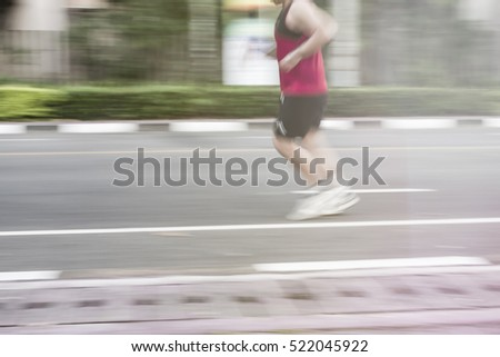 people running at parks outdoor with motion blur