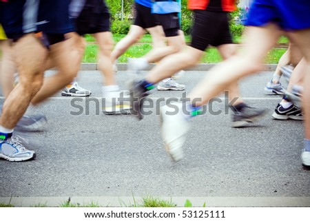 People running in city marathon on street, exercise outdoors - stock photo