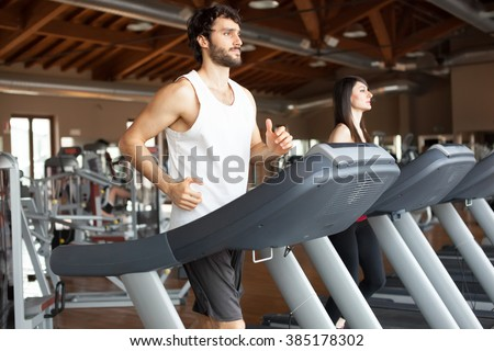 People running on treadmills - stock photo