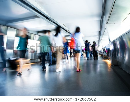 People rushing in the lobby. motion blur - stock photo