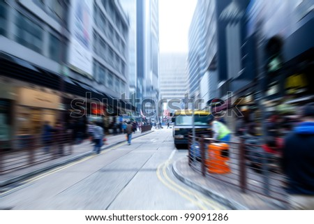 people rushing on the street in motion blur - stock photo