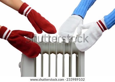 people's hands in mittens bask near a radiator on a white background
