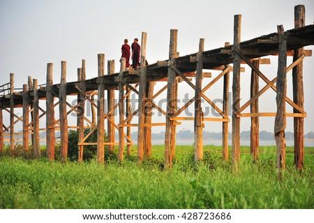 People's Life on U Bein Bridge in Myanmar - stock photo
