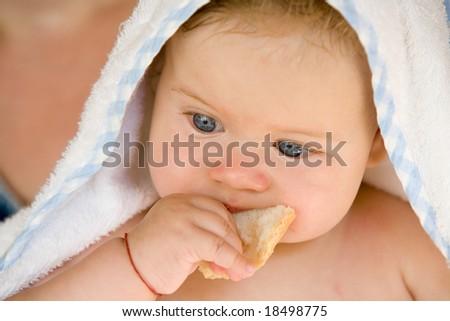 people series: portrait of adorable baby with bread