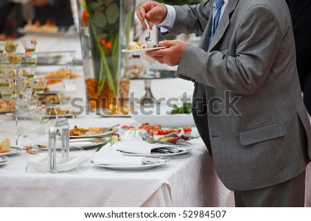 People serving at buffet: italian restaurant - stock photo