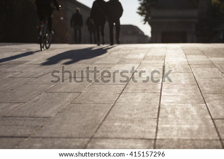 People shadows on streets in sunset, urban city life concept image - stock photo