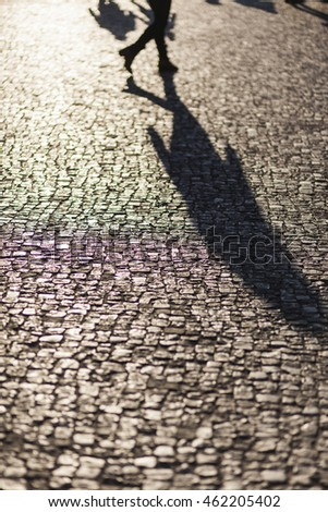 People shadows on streets in sunset, urban city life concept image