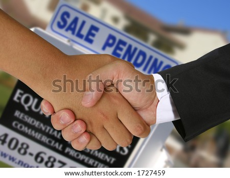 People shaking hands in a real estate transaction - stock photo