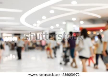 People shopping in department store.  Defocused blur background. - stock photo