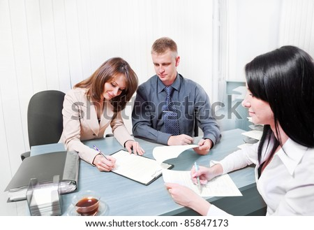 People signing contract in  office - stock photo