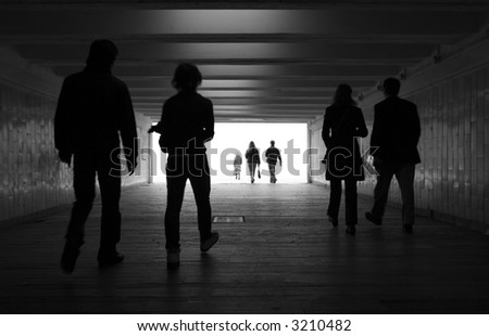 People silhouettes in a subway tunnel