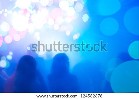 People silhouettes in festive colorful festive atmosphere.