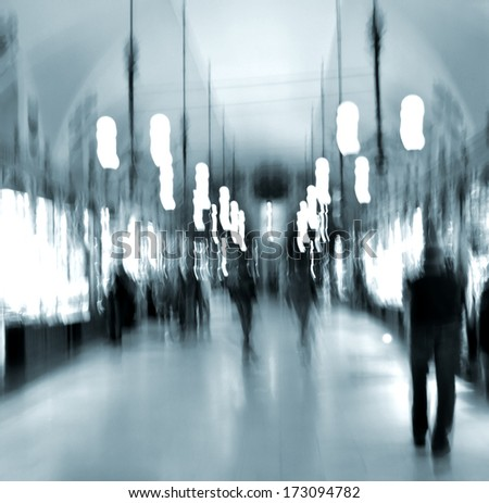 People silhouettes in shopping mall in motion blur