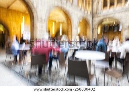 People siting, motion blur, zoom effect - stock photo