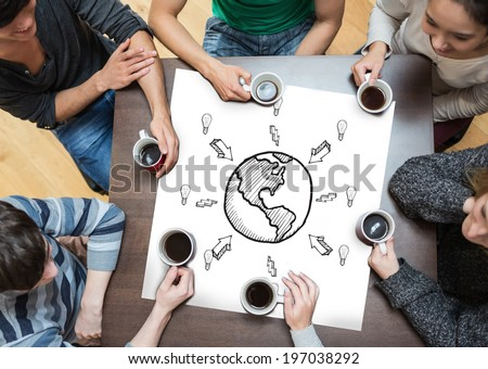 People sitting around table drinking coffee with page showing earth doodle with arrows - stock photo