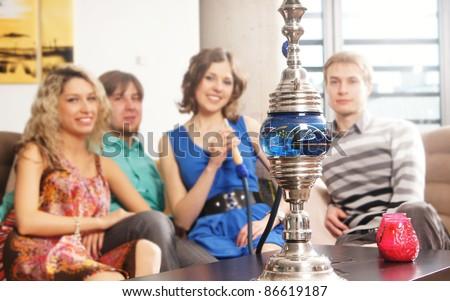 People smoking hookah. WARNING! The focus is only in hookah! - stock photo