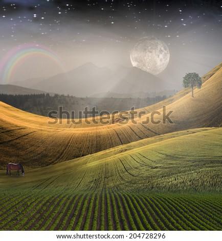 People soaring toward light amongst stars  - stock photo