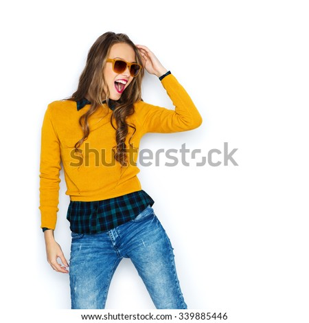 people, style and fashion concept - happy young woman or teen girl in casual clothes and sunglasses having fun - stock photo
