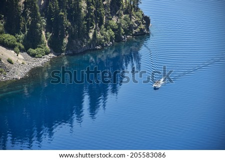 People taking a boat tour on Crater Lake - stock photo