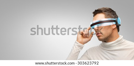 people, technology, future and progress - man with futuristic 3d glasses over gray background - stock photo