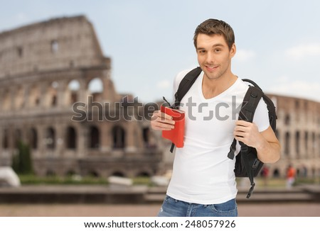 people, travel, tourism and education concept - happy young man with backpack and book travelling over coliseum background - stock photo